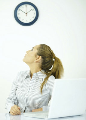 Woman staring at a clock